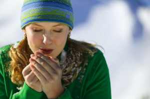 woman-blowing-into-cold-hands