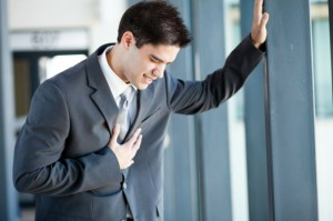 young-businessman-having-heart-attack-or-chest-pain