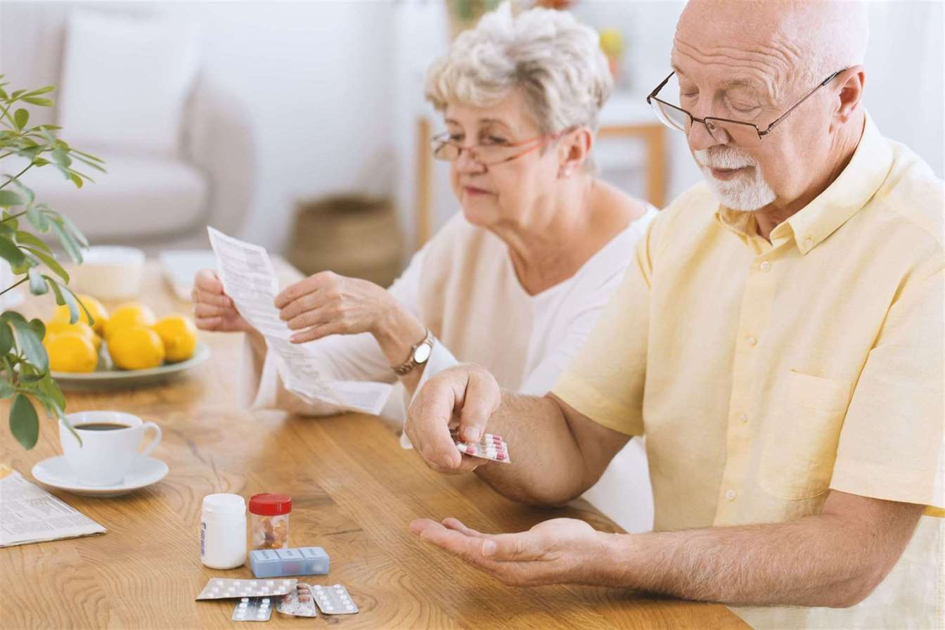 senior-man-taking-medication-for-diabetes-while-his-wife-reading-a-prescription